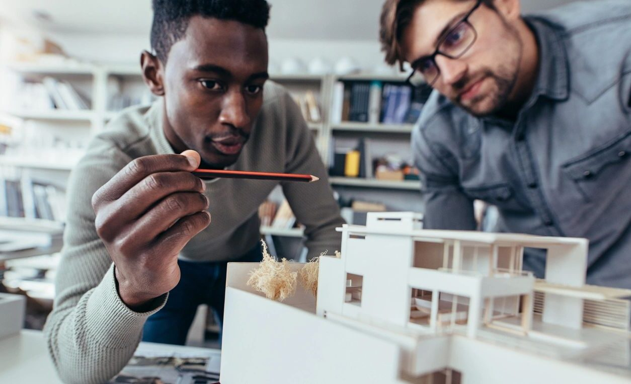 Diverse Team Working on an Architectural Model